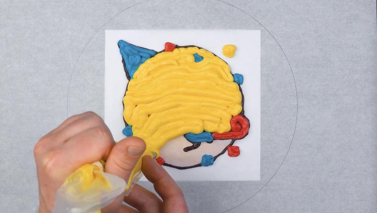 Emoji coberto com glacê colorido